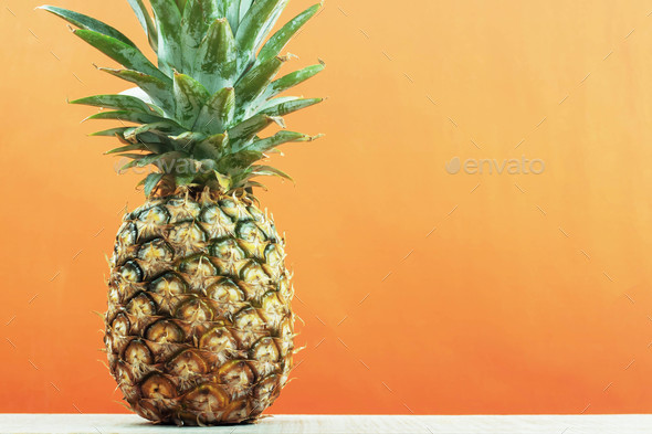 Pineapple with yellow background - Stock Photo - Images