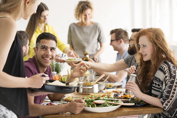 Friends eating healthy dinner - Stock Photo - Images