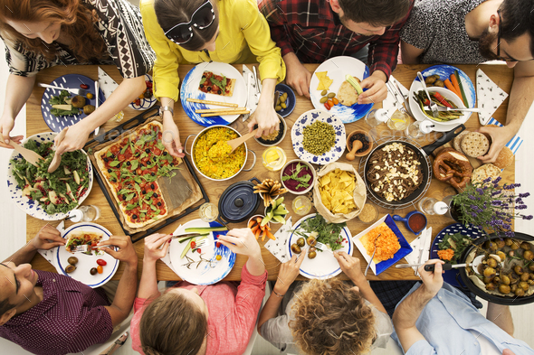 Vegan friends eating healthy dinner - Stock Photo - Images