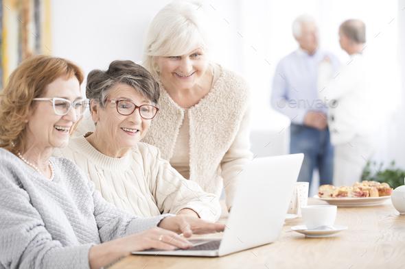 Smiling senior women using laptop - Stock Photo - Images