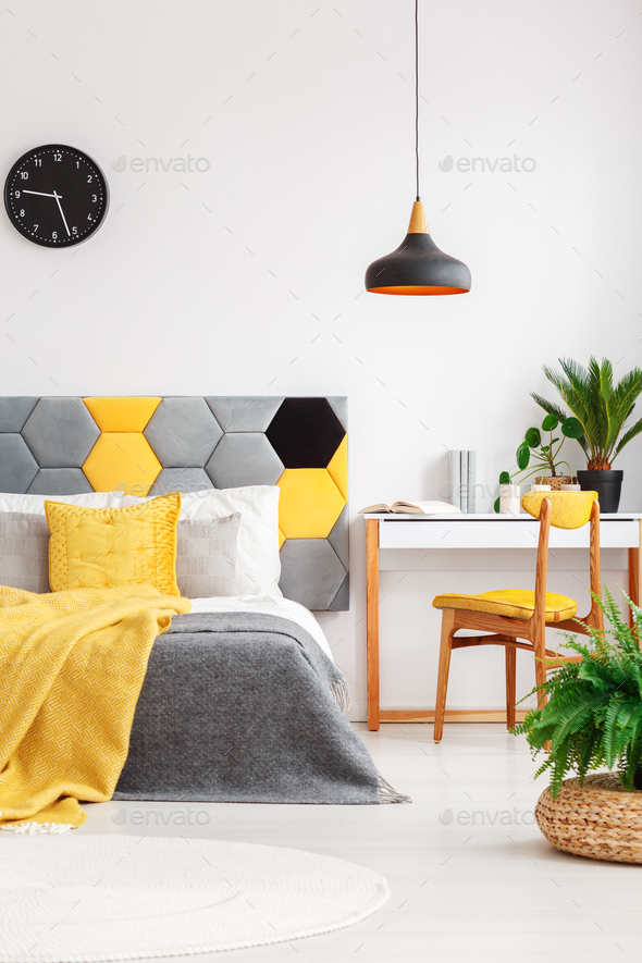 Plants in colorful bedroom interior - Stock Photo - Images