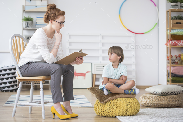 Offended young boy and teacher - Stock Photo - Images