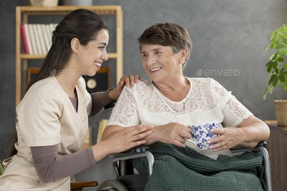 Smiling senior woman drinking tea - Stock Photo - Images