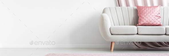 Pink pillow on beige couch - Stock Photo - Images