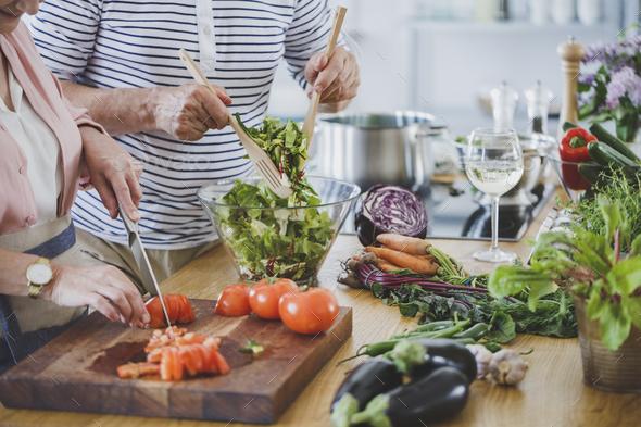 Senior people preparing healthy dinner - Stock Photo - Images