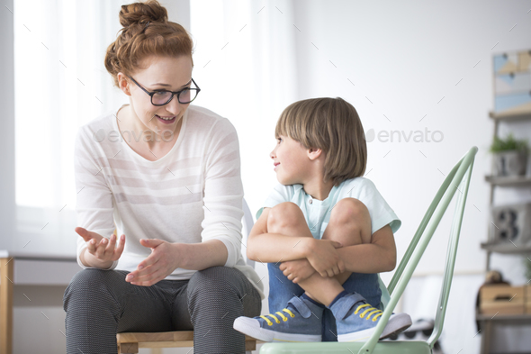 Mother talking to smiling son - Stock Photo - Images