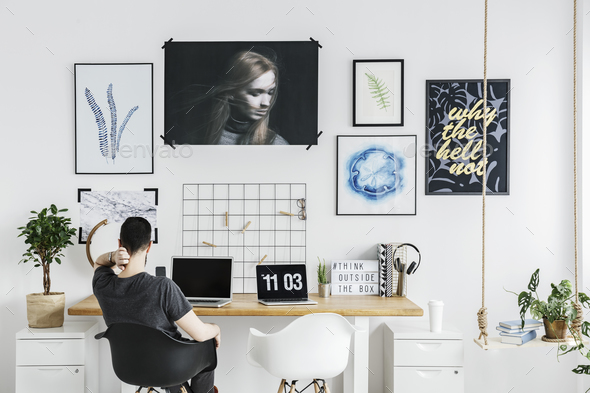 Man in white home office - Stock Photo - Images
