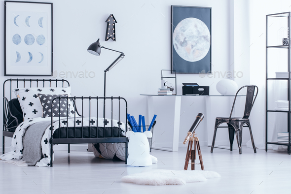 Telescope in teenager's bedroom - Stock Photo - Images