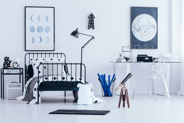 Lunar posters in child's bedroom - Stock Photo - Images