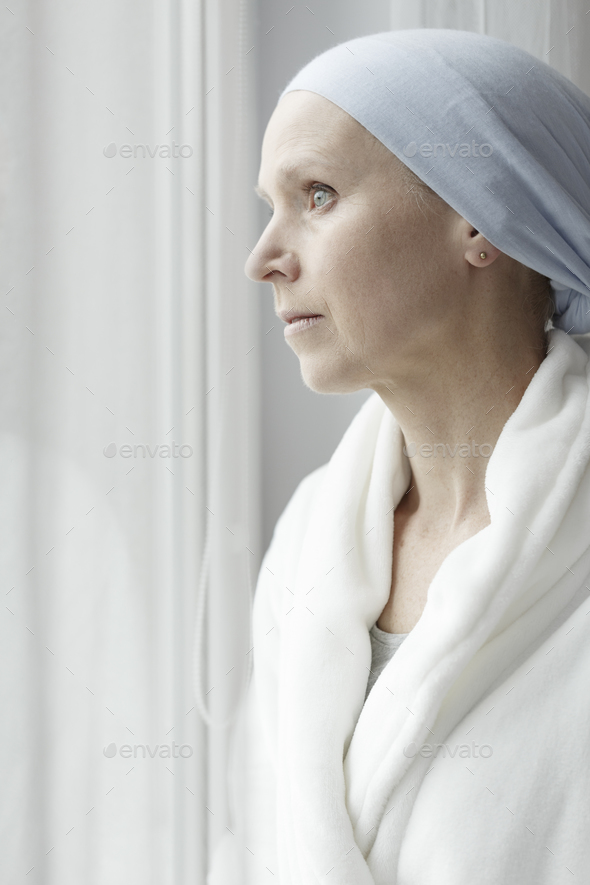 Sad woman with breast cancer - Stock Photo - Images