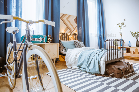 Bicycle in blue bedroom interior - Stock Photo - Images