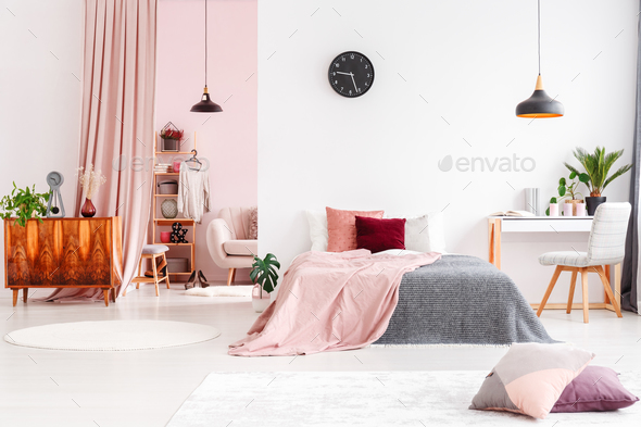 Spacious bedroom with pastel curtain - Stock Photo - Images