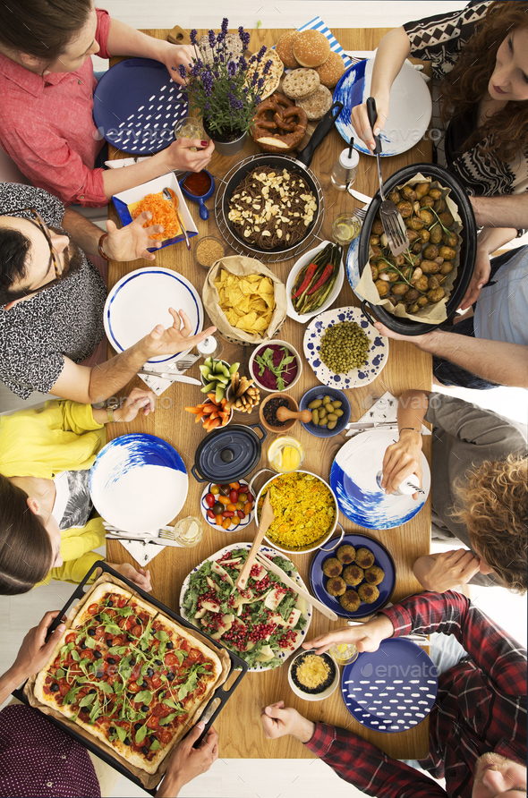 People eating pizza - Stock Photo - Images
