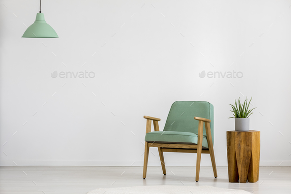 Vintage green armchair in room - Stock Photo - Images