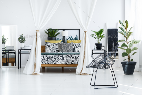 Bright bedroom interior with chair - Stock Photo - Images
