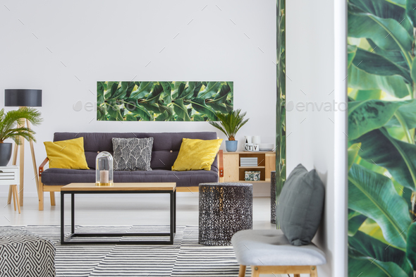 Spacious living room with poster - Stock Photo - Images