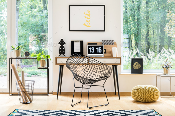 Yellow pouf in workspace - Stock Photo - Images