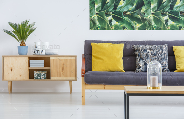 Cupboard and sofa with cushions - Stock Photo - Images