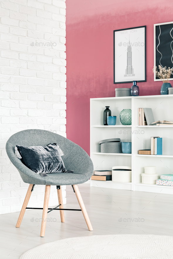 Grey armchair in living room - Stock Photo - Images