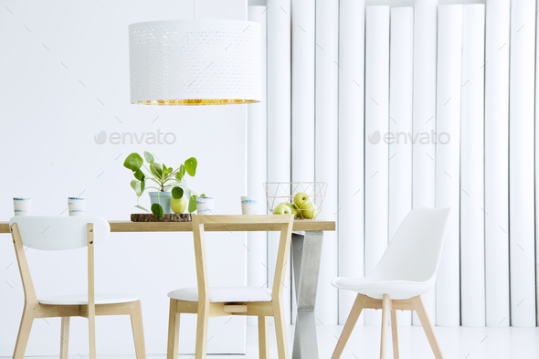 Wooden chairs in white interior - Stock Photo - Images