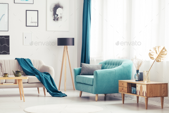Living room with blue armchair - Stock Photo - Images