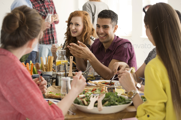Happy spanish man eating lunch - Stock Photo - Images