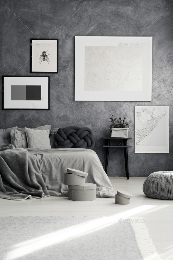 Monochromatic bedroom with gray pillows - Stock Photo - Images