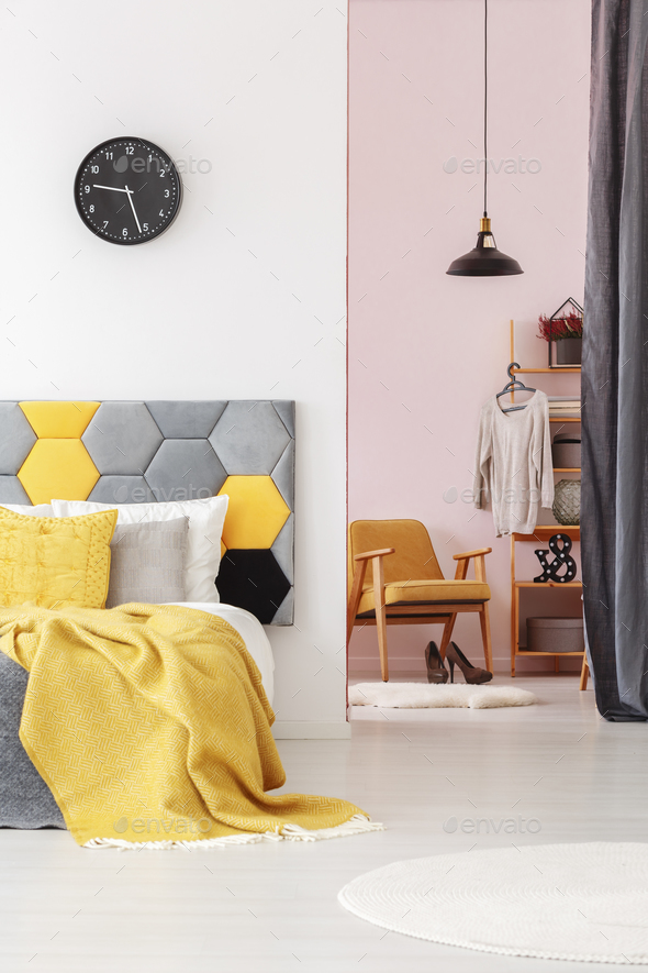 Yellow bedroom interior with clock - Stock Photo - Images
