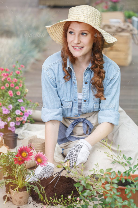 Preparing soil for replanting flowers - Stock Photo - Images