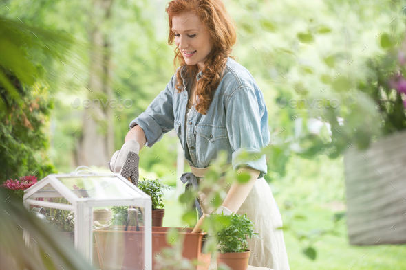 Happy girl planting flowers - Stock Photo - Images
