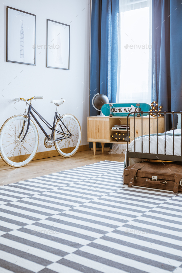 Bicycle in teenager's bedroom interior - Stock Photo - Images