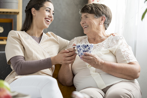 Granddaughter and smiling senior woman - Stock Photo - Images