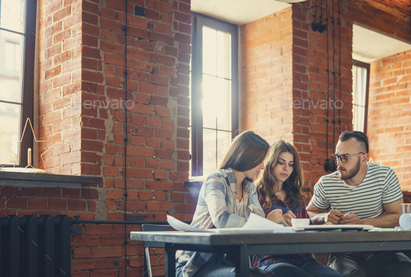 Working people in the loft - Stock Photo - Images