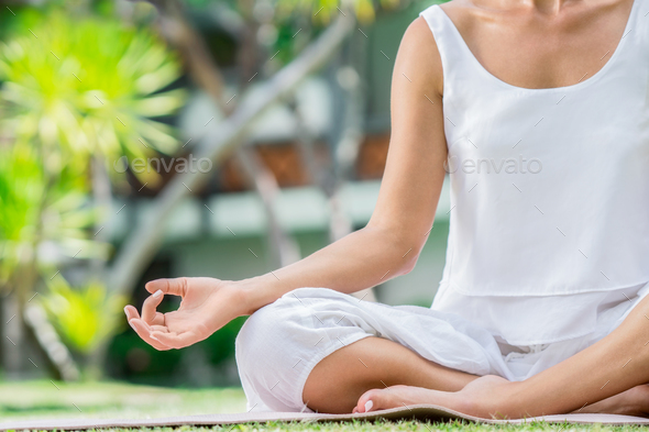 Meditation on a lawn - Stock Photo - Images