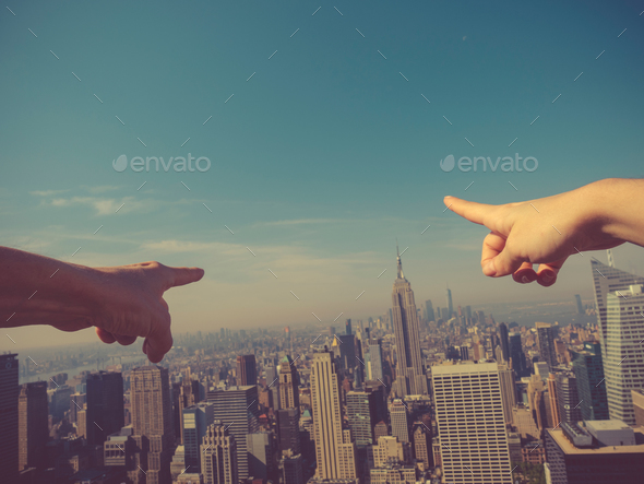 Finger showing the skyscrapers - Stock Photo - Images