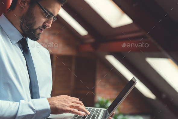 Young businessman indoors - Stock Photo - Images