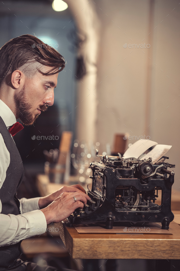 Writting man indoors - Stock Photo - Images