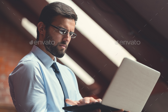 Businessman in workplace - Stock Photo - Images