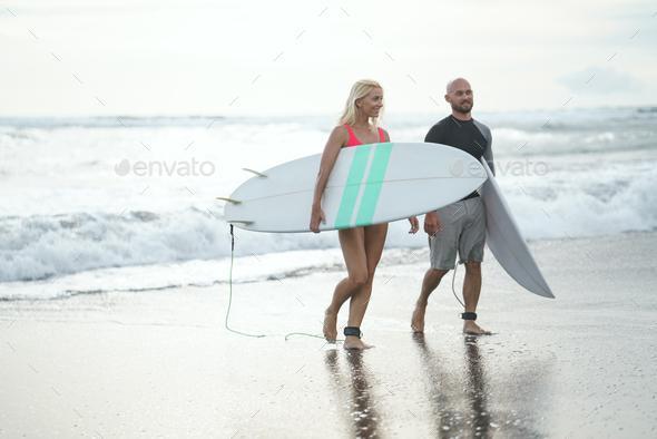 Surfers on the beach - Stock Photo - Images
