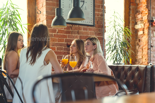 Young woman in a cafe - Stock Photo - Images