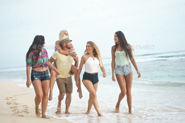 Young smiling friends outdoors - Stock Photo - Images