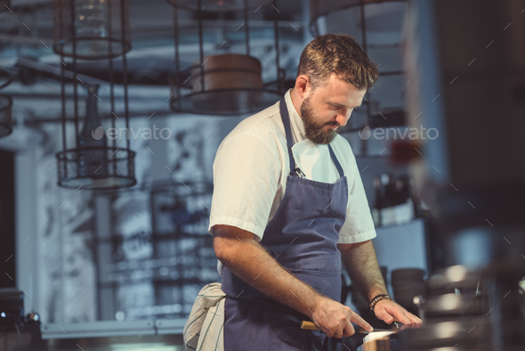Young man in the kitchen - Stock Photo - Images