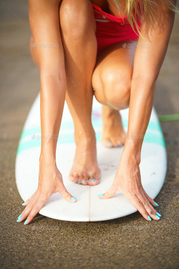 Young girl on surfboard - Stock Photo - Images