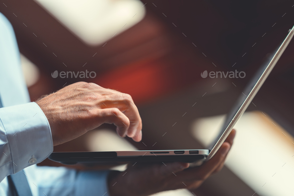 Working man with laptop - Stock Photo - Images