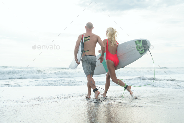 Active surfers outdoors - Stock Photo - Images