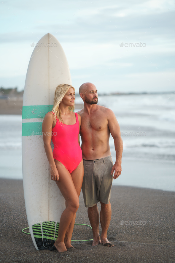 People with a surfboard - Stock Photo - Images