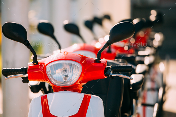 Many Electric Motorbikes, Motorcycles Scooters Parked In Row In - Stock Photo - Images