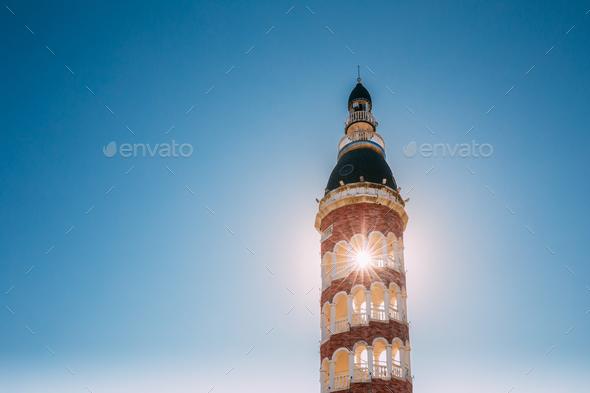 Batumi, Adjara, Georgia. Sun Shining Through Old Tower On Blue S - Stock Photo - Images
