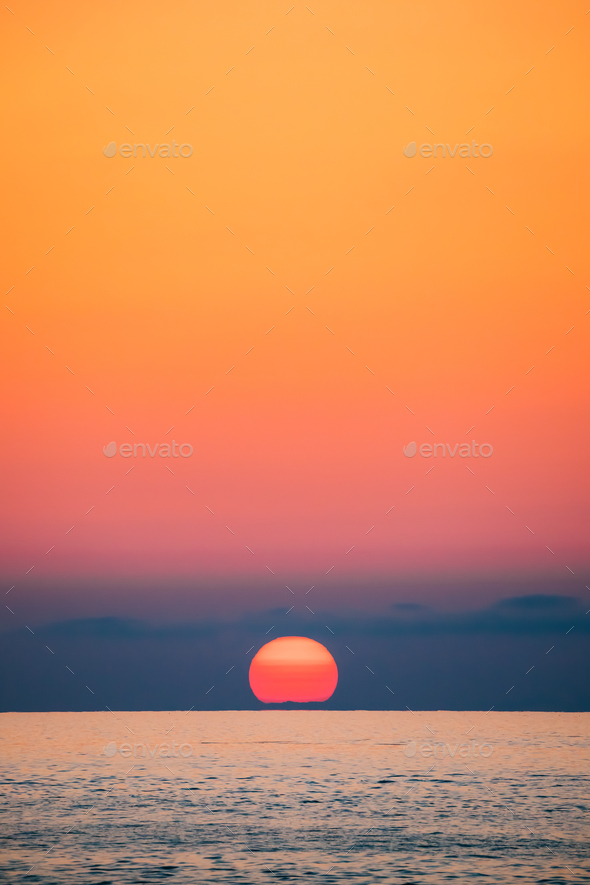 Sundown Above Sea Horizon At Sunset. Natural Sunrise Sky Warm Co - Stock Photo - Images