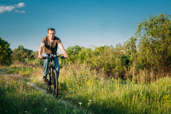 Man On Bike Bicycle Cycling  In Green Summer Sunny Park - Stock Photo - Images